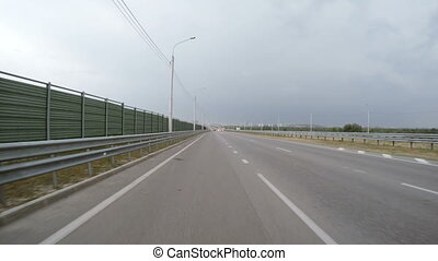 The car is driving exit from highway. Rear view. - The car...