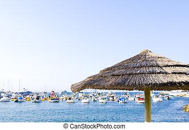 Palapa and Yachts - Tiki-Style Palapa against background of...
