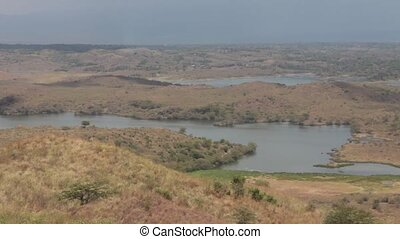 Lake in safari in Tanzania - Lake and rainy weather in...