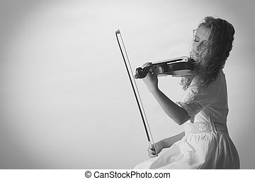 Musician violinist woman playing on violin