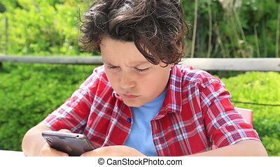 Young boy with smartphone