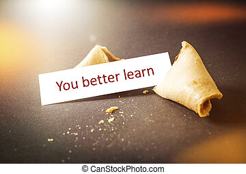 a fortune cookie with message you better learn
