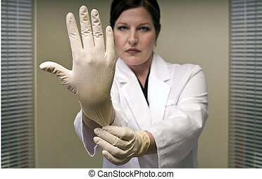 The Exam - Doctor or Nurse in Rubber Gloves