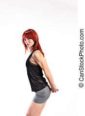 Attractive young fitness woman in black tank top. Studio...