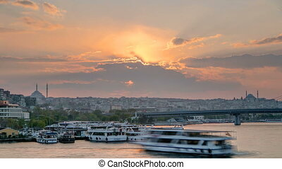 Passenger Ferry in the Bosphorus at sunset timelapse, Istanbul skyline, Turkey