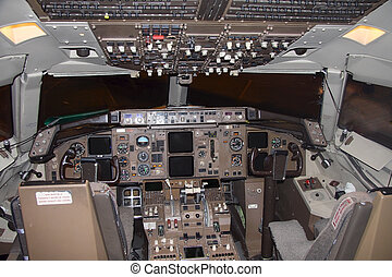 Commercial airplane cockpit - cockpit of a commercial...