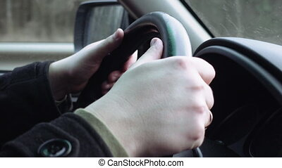 Hands on the steering wheel - Driver's hands on the steering...