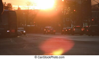 City traffic sunset - Sun goes down with traffic in the...