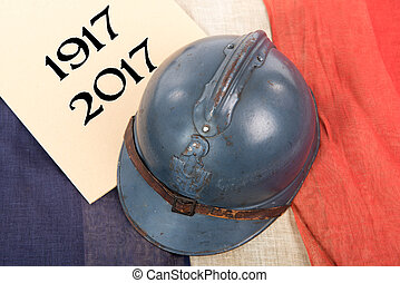 french military helmet of the First World War on red white...