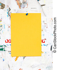 Empty colorful paper ad inserts on a dirty Board. Fastens...