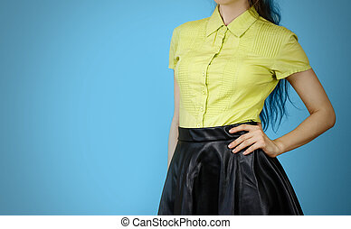 The girl in the yellow shirt and leather skirt. Isolated on...