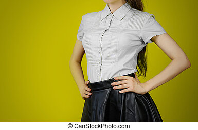 The girl in the grey shirt and leather skirt. Isolated on...