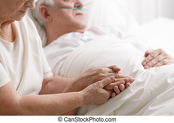Marriage holding hand's in hospital
