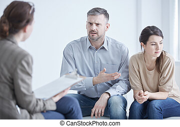 Complaining on wife - Handsome angry man complaining on his...