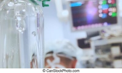 Drip with ECG monitor in operation room. - The ECG monitor...
