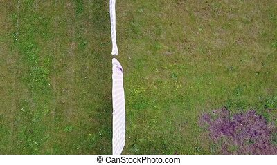 Aerial of clothes hanging on a clothesline in the yard
