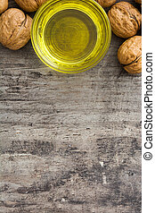 Walnuts oil in crystal bowl on wooden table