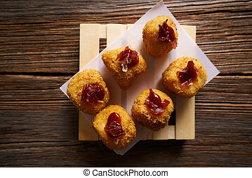 Tapas Croquettes rissole with iberian ham on top from Spain