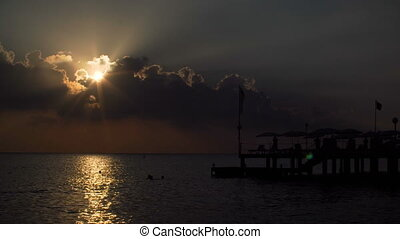 beautiful sunset on sea. silhouette of the pier in Mediterranean sea