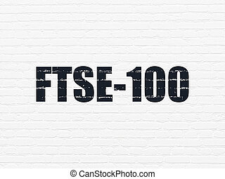 Stock market indexes concept: FTSE-100 on wall background -...