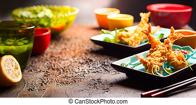 Shrimps tempura with spicy chili sauce on blue plate....