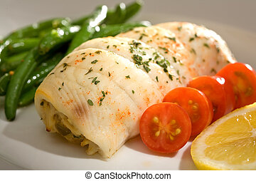 Crab Stuffed Flounder and Tomatoes - Gourmet dinner of crab...