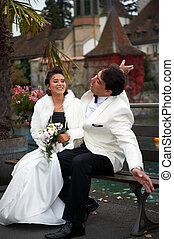 Smiling Bride And Groom - A smiling bride and groom are...