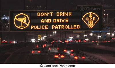 Donu2019t drink and Drive - Highway sign at night warning...