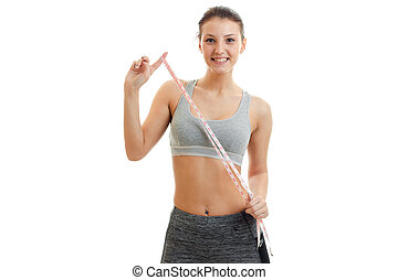 fun fitness girl grey top holding a measuring tape