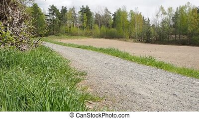 Fast running unrecognizable person on gravel road - Fast...