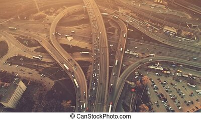 Aerial high drone flight over evening road traffic in Kiev,...
