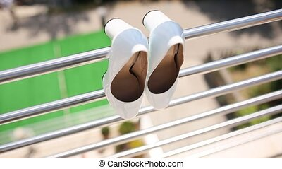 Wedding shoes of the bride on balcony - Wedding shoes of the...