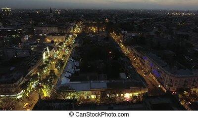center of Odessa on Deribasovskaya street at night. Aerial...