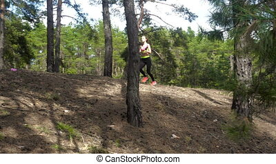 slim sports girl trains in forest - slim beautiful sports...