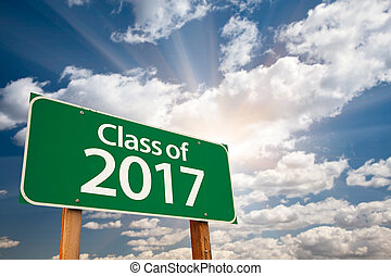 Class of 2017 Green Road Sign with Dramatic Clouds and Sky