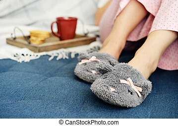 Girl in cute slippers - Girl in pink pajamas and cute...