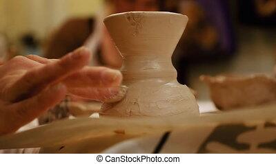 Ceramist is modeling clay pot or vase bowl - Child ceramist...