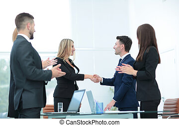 Handshake business partners and business team meeting in...