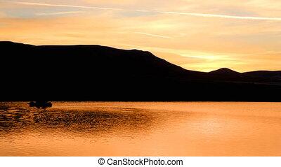 sunrise on morning lake