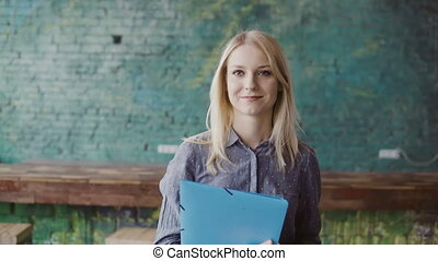 Portrait of successful beautiful blonde businesswoman at...