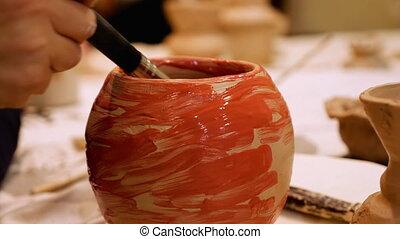 Ceramist is painting clay pot or vase bowl - Art ceramist...