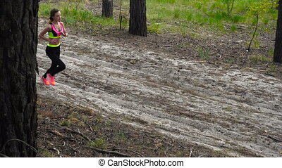athletic girl running around in the Woods - Charming...
