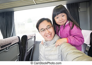 father and daughter selfie happily in the bus