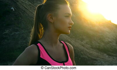 Portrait of a charming girl at sunset
