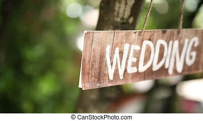 The tablet Wedding on an olive tree. Wedding decorations....