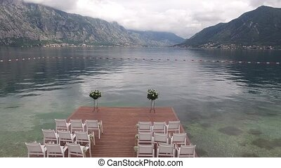 Wedding set on the docks in the Bay of Kotor. Wedding in...