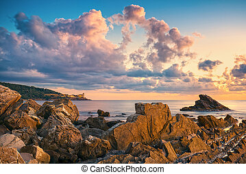 Rocks and buildings on the sea at sunset. Livorno, Tuscany...