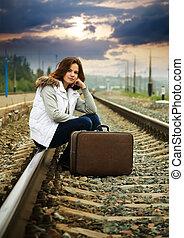 Sad girl on  railway