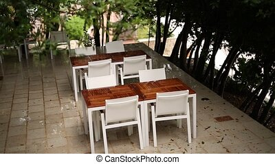 Tables in cafe on the street. Street Cafe. Restaurants in...