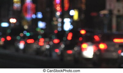 Defocused night traffic. - Traffic in the city with...